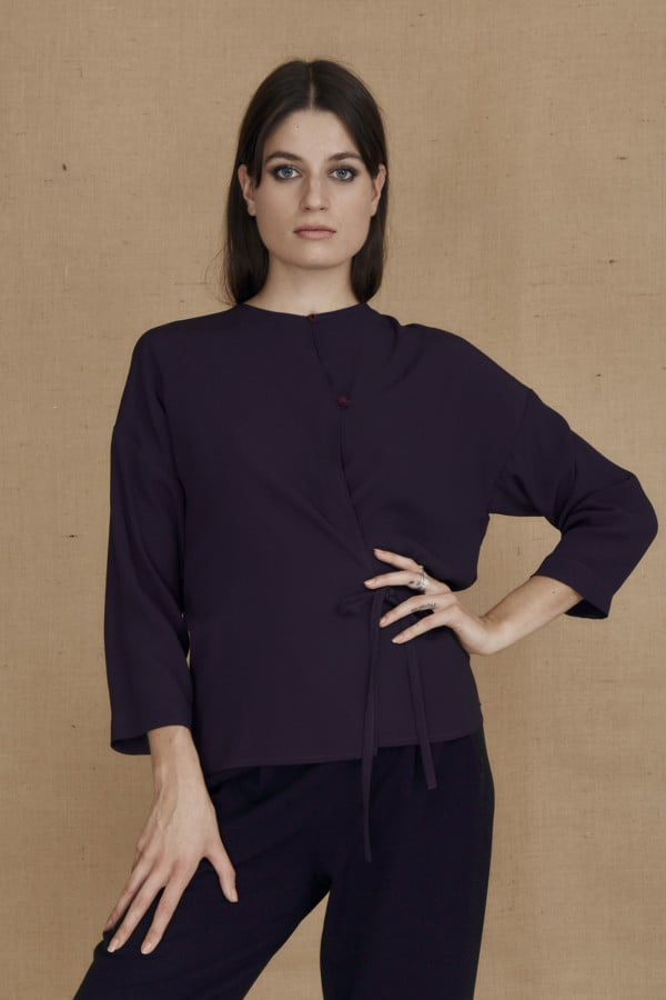 Flowing eggplant wrap blouse AI - 3