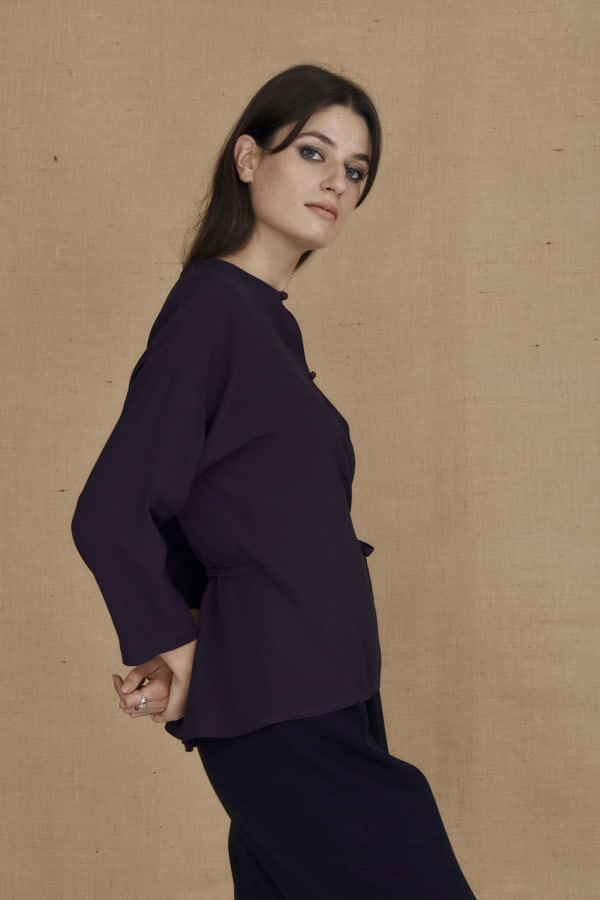 Flowing eggplant wrap blouse AI - 4